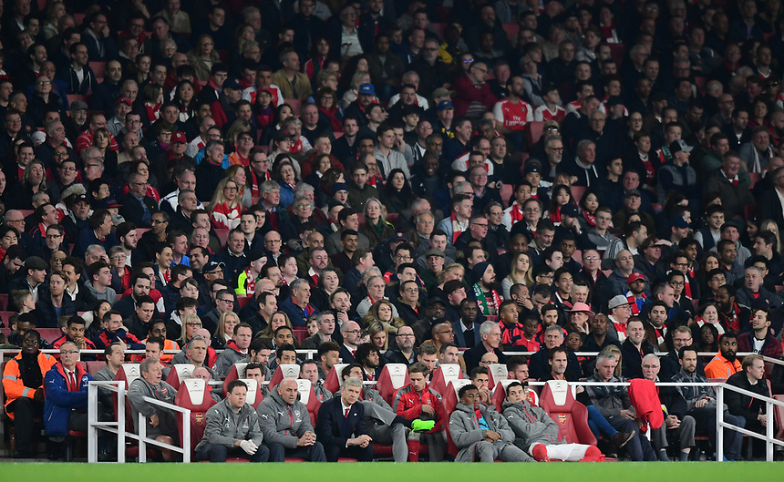 Arsenal manager Arsene Wenger (front row, third in from left)  sits in the dug-out<br /> <br /> Photographer Chris Vaughan/CameraSport<br /> <br /> The Emirates FA Cup Quarter-Final - Arsenal v Lincoln City - Saturday 11th March 2017 - The Emirates - London<br />  <br /> World Copyright &copy; 2017 CameraSport. All rights reserved. 43 Linden Ave. Countesthorpe. Leicester. England. LE8 5PG - Tel: +44 (0) 116 277 4147 - admin@camerasport.com - www.camerasport.com