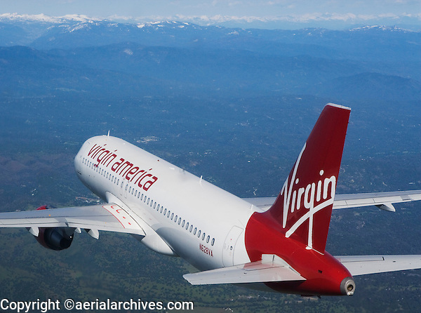 aerial photograph of N628VA, Virgin America Airlines Airbus A320-214, over the California's Central Valley heading to the Sierra Nevada mountains