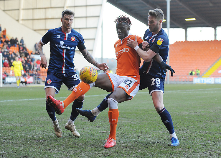 Blackpool's Armand Gnanduillet under pressure from Walsall's Cameron Norman<br /> <br /> Photographer Kevin Barnes/CameraSport<br /> <br /> The EFL Sky Bet League One - Blackpool v Walsall - Saturday 9th February 2019 - Bloomfield Road - Blackpool<br /> <br /> World Copyright &copy; 2019 CameraSport. All rights reserved. 43 Linden Ave. Countesthorpe. Leicester. England. LE8 5PG - Tel: +44 (0) 116 277 4147 - admin@camerasport.com - www.camerasport.com