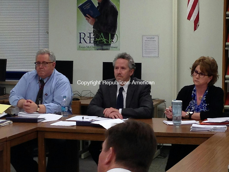 WOODBURY, CT - 26 March 2014 - 032614RH01 - Region 14 Director of Finance and Operations Wayne McAllister, left, Superintendent Jody Goeler, center, and Board of Education vice chairwoman Maryanne Van Aken, right, work on the district's budget at a meeting at Nonnewaug High School in Woodbury. Rick Harrison Republican-American