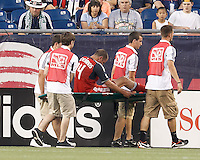 Toronto FC forward Danny Koevermans (14) carried off the field late in the first half. In a Major League Soccer (MLS) match, Toronto FC defeated New England Revolution, 1-0, at Gillette Stadium on July 14, 2012.