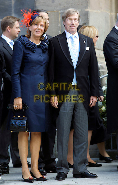 PRINCE LEOPOLD OF BRAVARIA & WIFE PRINCESS URSULA.Wedding of Hereditary Prince Hubertus of Sax -Coburg and Gotha and Kelly Rondestvedt in Coburg, Germany, .23rd May 2009..marriage full length  blue coat red hat bag handbag couple royal.CAP/PPG/JH.©Jens Hartmann/People Picture/Capital Pictures