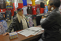 Grant Newburger, 50, a supporter of Bob Avakian's Revolutionary Communist Party, and Kimberly Castile, 31, at the clothing store where she works in an underground mall on the corner of Madison and Pulaski Streets on the West Side of Chicago, Illinois on February 29, 2008.  Castile's friend Freddie Latrice Wilson was shot and killed by a Chicago police officer on the West Side of Chicago on November 13, 2007.