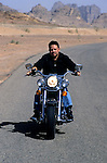 King Abdullah II of Jordan riding his motorcycle in Wadi Rum