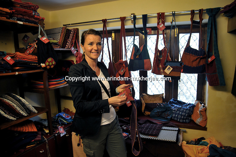 "Ms Leanne Nicolle, Director (Corporate Development) of Plan Canada checking Sadhna's products during her visit to the showroom of ""Sadhna"" in Udaipur, Rajasthan, India. 24.1.2011. Arindam Mukherjee"