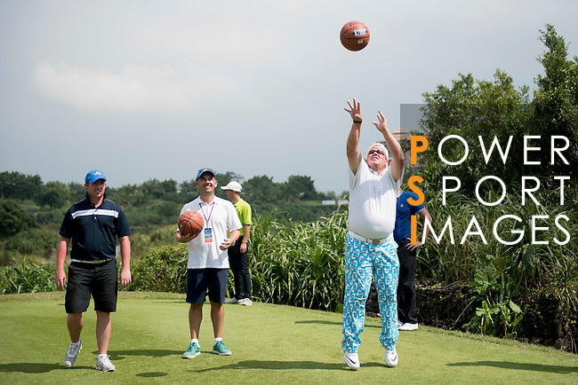 John Daly throws a basketball during the World Celebrity Pro-Am 2016 Mission Hills China Golf Tournament on 23 October 2016, in Haikou, Hainan province, China. Photo by Weixiang Lim / Power Sport Images