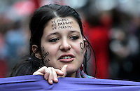 "Manifestazione nazionale contro la violenza maschile sulle donne, a Roma, 22 novembre 2008..A girl has his face painted with a slogan reading ""I am mine. Neither fathers, nor owners, nor husbands"" during a national rally against male violence on women in Rome, 22 november 2008..UPDATE IMAGES PRESS/Riccardo De Luca"
