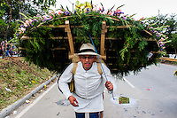 A man takes part during the 58th Silleteros' parade in the framework of the flowers' fair, this year the parade was declared intangible heritage of Colombia. Medellín, Colombia 09/08/2015