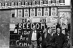 Derry Northern Ireland Londonderry 1979. The Troubles 1970s unemployed men city centre passing the time of day standing under wall poster for Long Kesh H Block Freedom Fighters are Not Criminals written on the wall. 70s UK