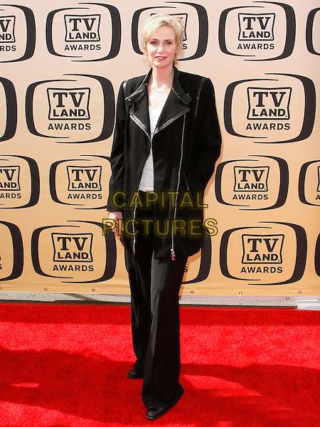 JANE LYNCH.The 8th Annual TV Land Awards held at  Sony Studios in Culver City, California.  .April 17th, 2010   .full length black trousers jacket white .CAP/ROT/BAR.©Barraza/Lee Roth/Capital Pictures