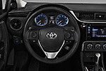 Car pictures of steering wheel view of a 2017 Toyota Corolla L 4 Door Sedan