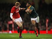 2nd December 2017, Principality Stadium, Cardiff, Wales; Autumn International Rugby Series, Wales versus South Africa; Warrick Gelant of South Africa hands off Rhys Patchell of Wales