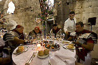 Roman legionnaires and gladiators, coming from the Gladiator School in Rome, sitting at a restaurant during celebrations at the Diocletian's Night in Split..