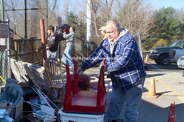 SOUTHBURY, CT.- 15 NOVEMBER 2014 - 111514JW01 - Southbury resident Steve Varga places and end table in a pile of discarded but still good items at the Southbury Recycling Center Saturday afternoon.  Jonathan Wilcox Republican-American