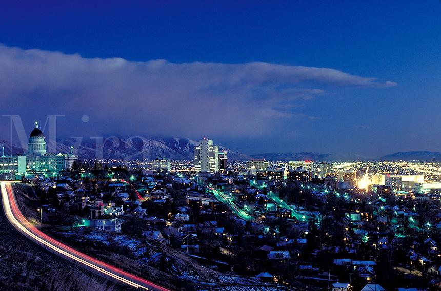 Utah State Capitol Building and Salt Lake City, Utah at dusk with the city lights on. cityscape, urban design, skyline. Salt Lake City Utah.