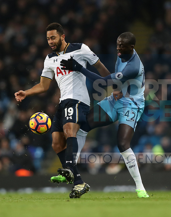 Yaya Toure of Manchester City and Mousa Dembélé of Tottenham Hotspur during the Premier League match at Etihad Stadium, Manchester. Picture date: January 21st, 2017.Photo credit should read: Lynne Cameron/Sportimage