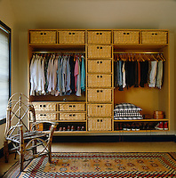 Wicker drawers are used for storage in this open-plan wardrobe