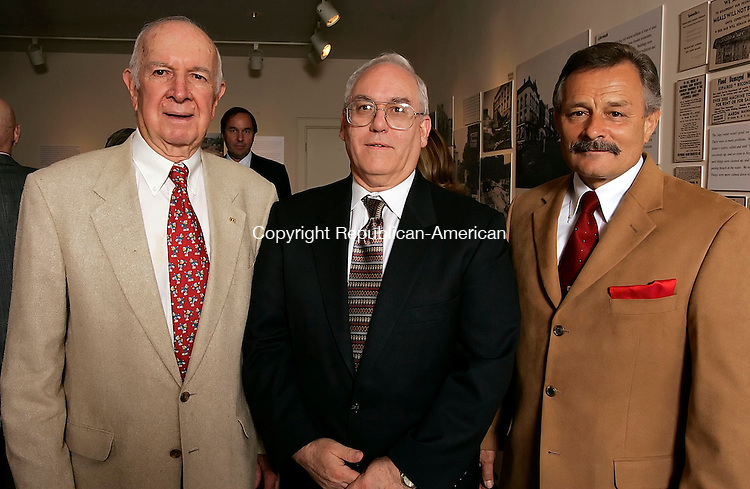WATERBURY, CT - 20 September 2005 -092005JS06--Milton Grele, Chairman of the Board for Platt Brothers and Company, left, Tom Tassis, Platt Brothers Secretary and Treasurer and Jim Behuniak, President and CEO at the birthday celebration for Orton P. Camp, Jr., at the Mattatuck Museum in Waterbury to thank his for his philanthropic work at the museum.    --Jim Shannon / Republican-American  --Tom Tassis; Milton Grele; Jim Behuniak; Mattatuck Museum; Waterbury are CQ