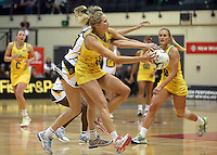 25.10.2012 Australia's Erin Bell and South Africa's Karla Mostert in action during the England v Australia netball test match as part of the Quad Series played at the TSB Arena Wellington. Mandatory Photo Credit ©Michael Bradley.