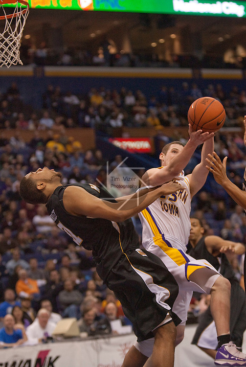 March 7,  2010          Wichita State forward/center J.T. Durley (31) goes flying backwards after getting elbowed by Northern Iowa guard Johnny Moran (13)] as he pulls down a second half rebound.   The University of Northern Iowa defeated Wichita State 67-52 on Sunday March 7, 2010 in the championship game of the Missouri Valley Conference Tournament at the Scottrade Center in downtown St. Louis.   They automatically earn a berth in the NCAA Tournament.