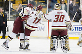 Tommy Cross (BC - 4), Pat Mullane (BC - 11), Chris Venti (BC - 30) - The Boston College Eagles defeated the Boston University Terriers 3-2 (OT) in their Beanpot opener on Monday, February 7, 2011, at TD Garden in Boston, Massachusetts.