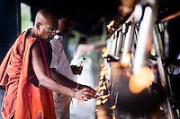 Sacred City of Anuradhapura, Buddhist monk praying at Sri Maha Bodhi in the Mahavihara (The Great Monastery), Sri Lanka, Asia