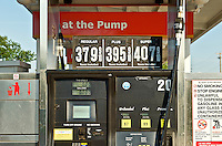 Gas station pump with high prices.