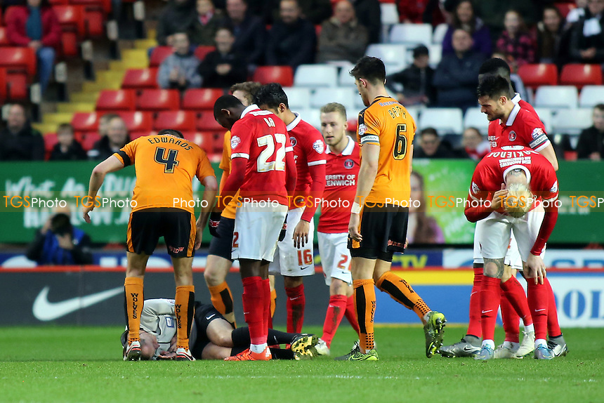 Charlton and Wolves players show their concern as referee, Mr Keith Hill, lies on the ground after a first half collision with Charlton's Simon Makienok who is holding his head during Charlton Athletic vs Wolverhampton Wanderers, Sky Bet Championship Football at The Valley, London, England on 28/12/2015