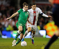 29th March 2015; UEFA EURO 2016 Championship Qualifier Group D, Ireland vs Poland, Aviva Stadium, Dublin<br /> Republic of Ireland's Seamus Coleman with Robert Lewandowski of Poland.<br /> Picture credit: Tommy Grealy/actionshots.ie.