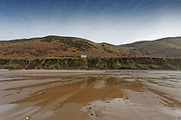 Pictured: The National Trust cottage near the landslide (seen left) by Rhossili beach. Tuesday 18 February 2020<br /> Re: General view of Rhossili in the Gower Peninsula near Swansea, Wales, UK.