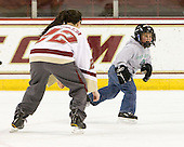 Mary Restuccia (BC - 22) played tag with a pair of young skaters. - The Boston College Eagles defeated the visiting Northeastern University Huskies 2-1 on Sunday, January 30, 2011, at Conte Forum in Chestnut Hill, Massachusetts.