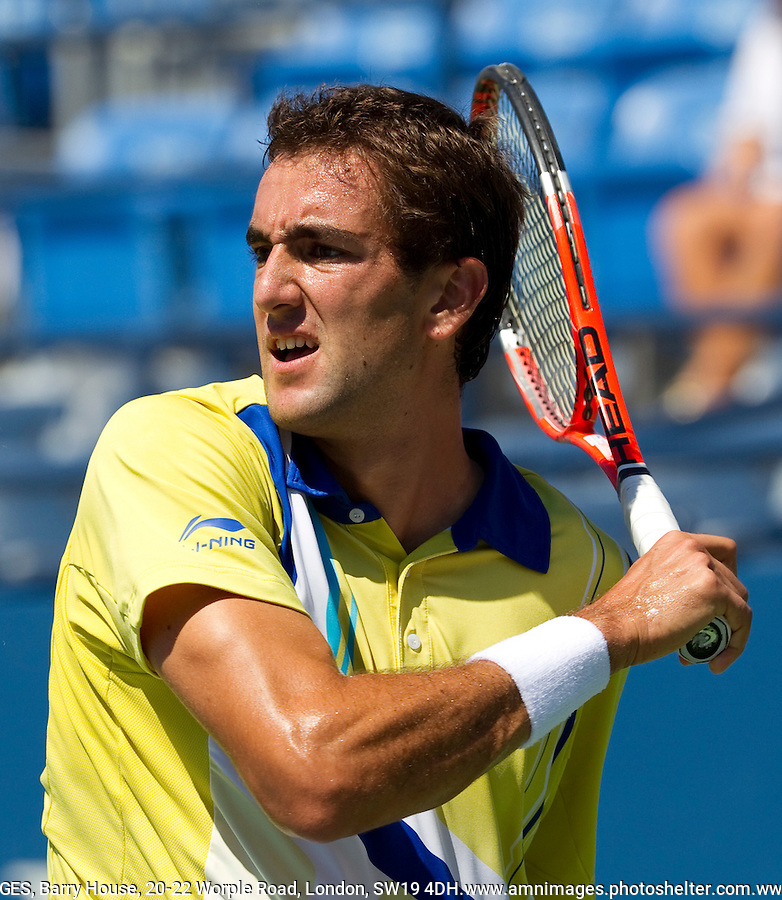 MARIN CILIC (CRO) (27) against RYAN HARRISON (USA) in the 1st round of the men's singles. Marin Cilic beat Ryan Harrison 6-2 7-5 7-6..Tennis - Grand Slam - US Open - Flushing Meadows - New York - Day 01 - Mon August 29th  2011..© AMN Images, Barry House, 20-22 Worple Road, London, SW19 4DH, UK..+44 208 947 0100.www.amnimages.photoshelter.com.www.advantagemedianetwork.com.