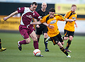 Arbroath's Alex Keddie and Alloa's Kevin Cawley challenge for the ball.
