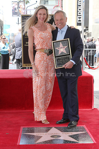 HOLLYWOOD, CA - APRIL 26: Chef Wolfgang Puck pictured as Chef Wolfgang Puck is honored with a Star on the Hollywood Walk of Fame on April 26, 2017 in Hollywood, California. Credit: FS/MediaPunch