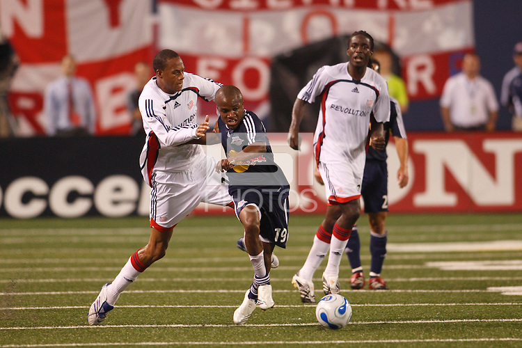 New England Revolution forward (18) Khano Smith and New York Red Bulls midfielder (19) Dane Richards. The New York Red Bulls and the New England Revolution played to a 2-2 tie in an MLS regular season match at Giants Stadium in East Rutherford, NJ, on September 22, 2007.