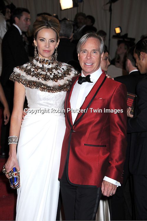 "Dee and Tommy Hilfiger arriving at The Costume Institute Gala Benefit celebriting ""Alexander McQueen: Savage Beauty"" at The Metropolitan Museum of Art in New York City on May 2, 2011."