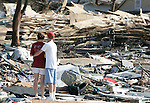 "Rachel and Cory Gregs, of Biloxi, Mississippi, take a moment to themselves as they stand in what used to be their apartment at the Quiet Water Apartments on Beach Blvd August 30, 2005.  Hurricane Katrina completely obliterated over 100 units of the Quiet Water apartments and St Charles Condiminiums with a reported 30 fatalities August 30, 2005.  ""There were more than 80 ifatalities n Harrison County"" according to Mississippi Governor Haley Barbour."
