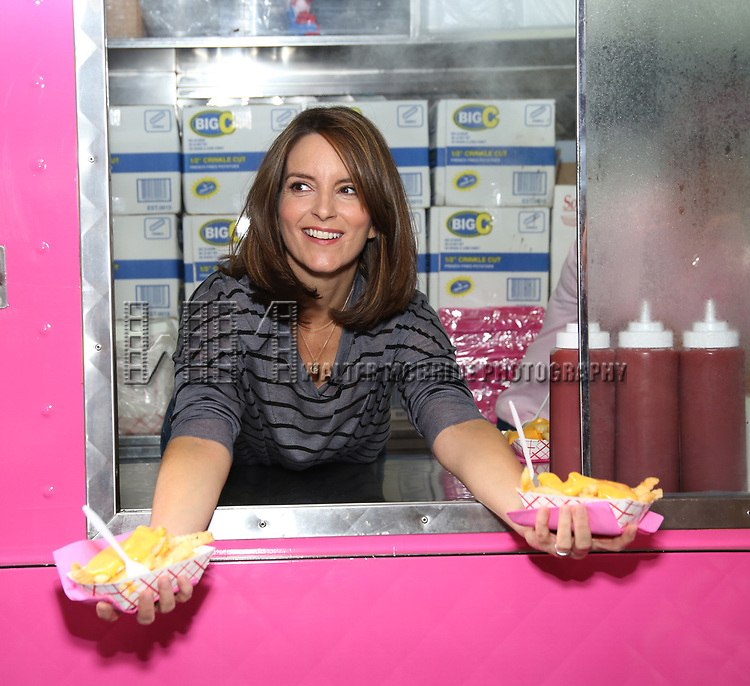 'Mean Girls' bookwriter Tina Fey serves cheese fries to fans in celebration of 'Mean Girls' Box Office Opening Day on Broadway at the August Wilson Theatre on October 3, 2017 in New York City.