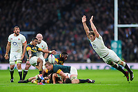 Rudy Paige of South Africa box-kicks the ball as Joe Launchbury of England looks to charge him down. Old Mutual Wealth Series International match between England and South Africa on November 12, 2016 at Twickenham Stadium in London, England. Photo by: Patrick Khachfe / Onside Images