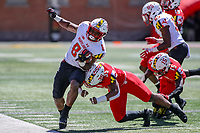 College Park, MD - April 27, 2019:  Maryland Terrapins linebacker Kobi Thomas (35) tackles Maryland Terrapins running back Tayon Fleet-Davis (8) during the spring game at  Capital One Field at Maryland Stadium in College Park, MD.  (Photo by Elliott Brown/Media Images International)