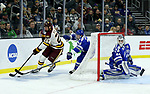 SIOUX FALLS, SD - MARCH 24: Riley Tufte #27 from Minnesota Duluth pushes the puck behind the net past Zack Mirageas #74 from Air Force during their game at the 2018 West Region Men's NCAA DI Hockey Tournament at the Denny Sanford Premier Center in Sioux Falls, SD. (Photo by Dave Eggen/Inertia)