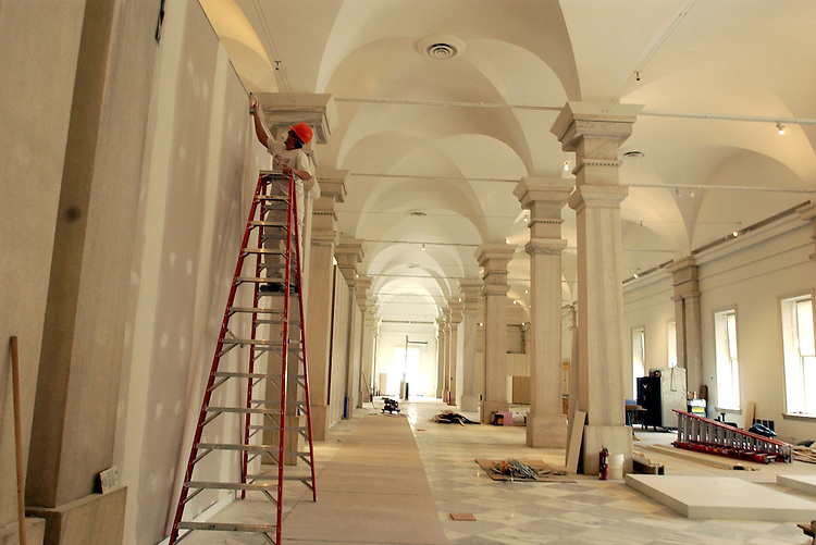 A painter works in a hall in the National Portrait Gallery and the Smithsonian American Art Museum, that is scheduled to open July 1, 2006, after a six year renovation project.