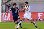 Tsukasa Shiotani of Japan (L) fights for the ball with Otabek Shukurov of Uzbekistan (R) during the AFC Asian Cup UAE 2019 Group F match between Japan (JPN) and Uzbekistan (UZB) at Khalifa Bin Zayed Stadium on 17 January 2019 in Al Ain, United Arab Emirates. Photo by Marcio Rodrigo Machado / Power Sport Images