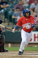 Outfielder Endy Chavez #5 of the Round Rock Express sprints out of the box against the Oklahoma City RedHawks on April 26, 2011 at the Dell Diamond in Round Rock, Texas. (Photo by Andrew Woolley / Four Seam Images)