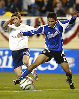 New England Revoluation midfielder Steve Ralston and San Jose Earthquakes forward Brian Ching challenge for a loose ball during their teams' 2005 MLS match on April 2, 2005 at Spartan Stadium in San Jose, California.  The match ended in a 2-2 tie.