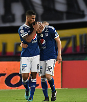 BOGOTA - COLOMBIA - 01 – 04 - 2018: Cesar Carrillo, jugador de Millonarios, celebra con sus compañeros de equipo después de anotar el primer gol de su equipo, durante partido de la fecha 12 entre Millonarios y Atletico Bucaramanga, por la Liga Aguila I 2018, jugado en el estadio Nemesio Camacho El Campin de la ciudad de Bogota. / Cesar Carrillo, player of Millonarios celebrates with his teammates after scoring the first goal of his team, during a match of the 12th date between Millonarios and Atletico Bucaramanga,  for the Liga Aguila I 2018 played at the Nemesio Camacho El Campin Stadium in Bogota city, Photo: VizzorImage / Luis Ramirez / Staff.