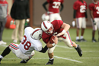 11 April 2007: Austin Yancy tackles Ben Ladner during spring practice at the practice field in Stanford, CA.