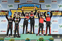 IMSA Continental Tire SportsCar Challenge<br /> Biscuitville Grand Prix<br /> Virginia International Raceway, Alton, VA USA<br /> Saturday 26 August 2017<br /> 28, Porsche, Porsche Cayman GT4, GS, Dylan Murcott, Dillon Machavern, 59, Ford, Ford Mustang, Dean Martin, Jack Roush Jr, 57, Chevrolet, Chevrolet Camaro GT4.R, Matt Bell, Robin Liddell, celebrate the win in victory lane on the podium<br /> World Copyright: Scott R LePage<br /> LAT Images