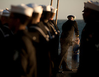 111201-N-DR144-465 PACIFIC OCEAN (Dec. 1, 2011) Chaplain Lt. Gregory Hazlett commits cremated remains to the sea during a burial at sea ceremony for 20 former service members aboard Nimitz-class aircraft carrier USS Carl Vinson (CVN 70). Carl Vinson and Carrier Air Wing (CVW) 17 are currently underway on a Western Pacific deployment.  (U.S. Navy photo by Mass Communication Specialist 2nd Class James R. Evans/Released)