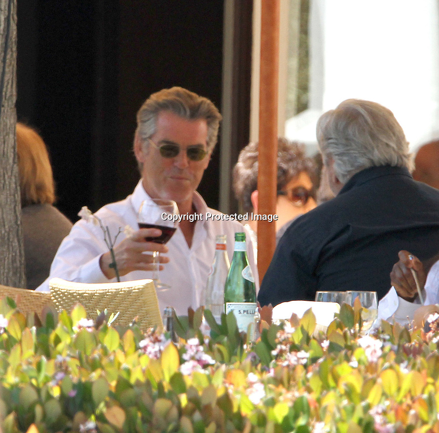 .April 15th 2011 Exclusive ..Pierce Brosnan eating lunch drinking red wine with a friend in Malibu California wearing sunglasses Tra Di Noi restaurant wearing a white dress shirt & suit ..www.AbilityFilms.com.805-427-3519.AbilityFilms@yahoo.com